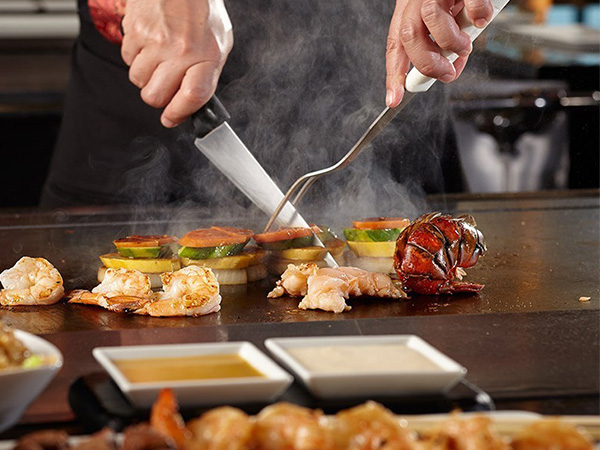 83e78820a5ca Teppanyaki (鉄板焼き teppan-yaki) is a style of Japanese cuisine that uses an  iron griddle to cook food. The word Teppanyaki is derived from teppan (鉄板)